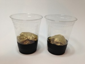 Like A Pot O Gold - Plastic Cups Stuffed With Gold Tissue Paper
